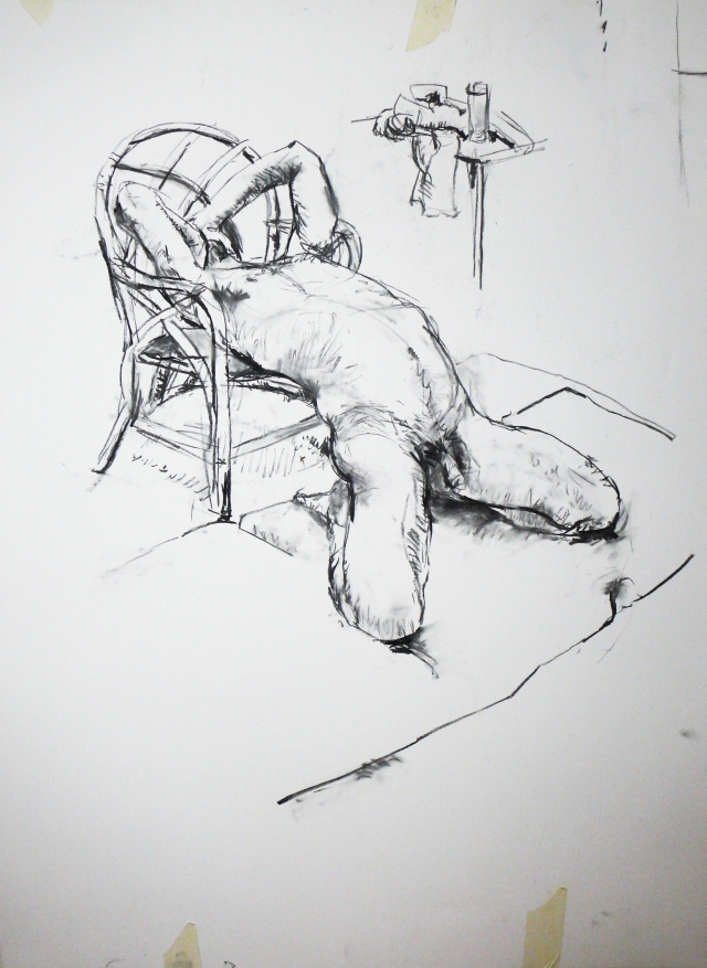Man stretched on chair