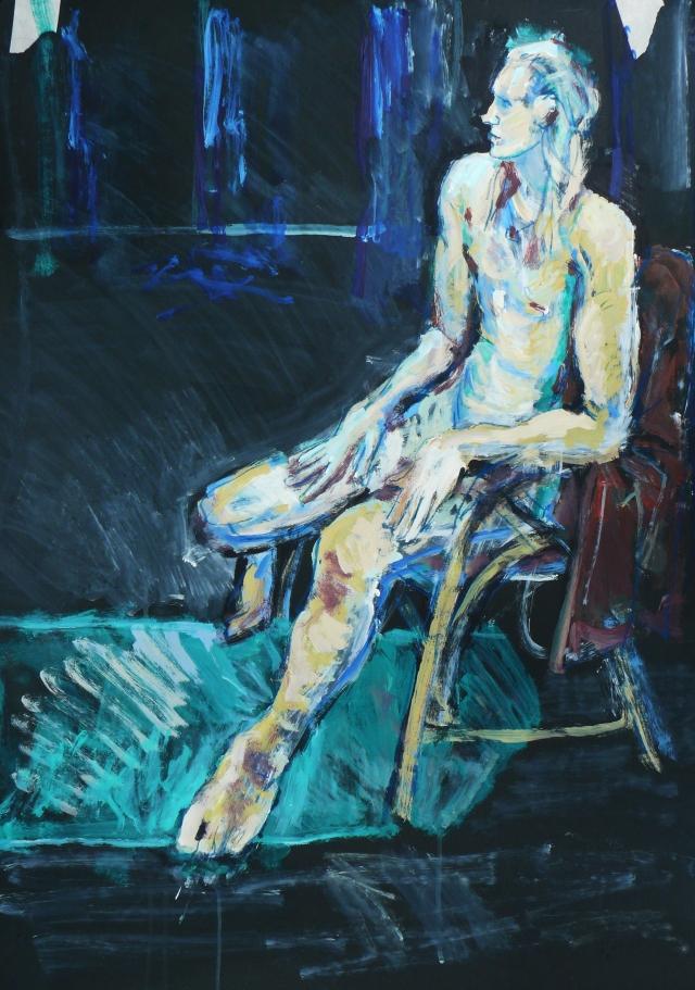 Blonde_male_dancer_sitting_on_black