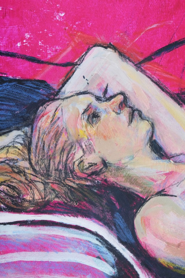 M reclining on red paper detail